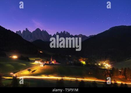 Night starry sky over Santa Maddalena village in Dolomites Alps, Italy - Stock Photo