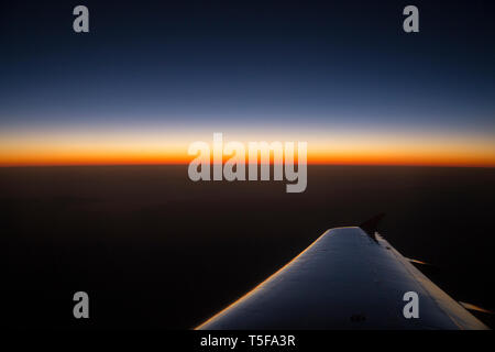 Horizon sunset view from airplane window - Stock Photo