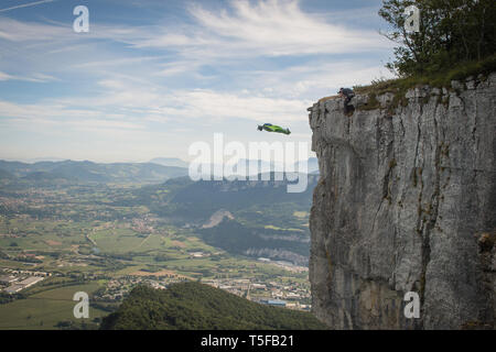 CHORANCHE, FRANCE - AUGUST 20: A wingsuit jumper jumping from a cliff in france, Auvergne-rhône-alpes, Choranche, France on August 20, 2015 in Choranche, France. (Photo by Fred Marie/Art in All of Us/Corbis via Getty Images) - Stock Photo