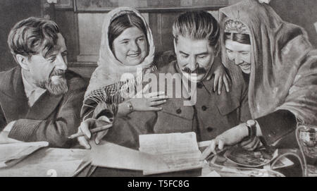 Joseph Vissarionovich Stalin on the soviet propaganda poster, by his example, opened the doors of the school to the people. - Stock Photo