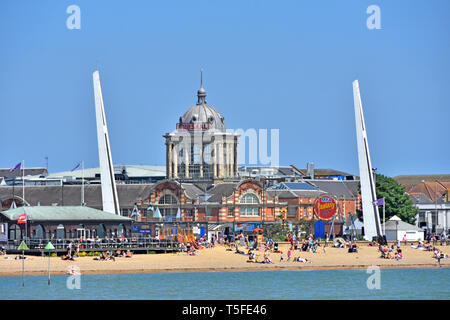 People at Southend on Sea seaside family beach dome of famous Victorian Kursaal amusement park beside River Thames Estuary Southend Essex England UK - Stock Photo