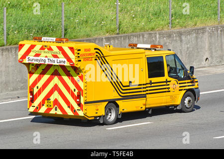 Purpose built yellow high visibility specialised highway maintenance surveying & road assessment vehicle by WDM Limited driving on motorway England UK - Stock Photo