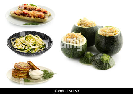 Different tasty dishes with zucchini on white background - Stock Photo