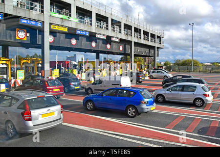 Short queues of traffic at toll booths on Wallasey side of Kingsway tunnel passing under River Mersey linking with Liverpool Merseyside England UK - Stock Photo