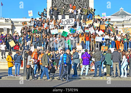 Group of teenage student boys & girls & school children kids miss school to strike protest on climate change wave placards & chant London England UK - Stock Photo