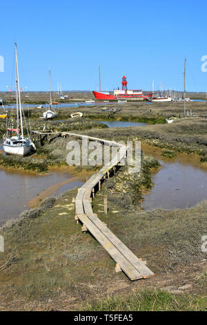Essex coast landscape & coastal countryside from Tollesbury Wick with River Blackwater salt marshes mud yacht mooring area & moored red lightship UK - Stock Photo