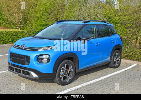 Side & front view of a new 2019 blue Citroen C3 Aircross mini SUV Flair variant with petrol engine 5 door right hand drive hatchback automobile car uk - Stock Photo