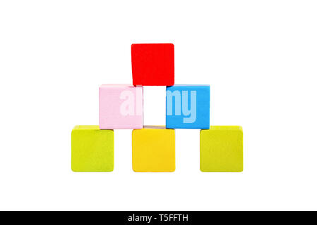Colorful wooden building blocks tower isolated on white background. Children toys. - Stock Photo