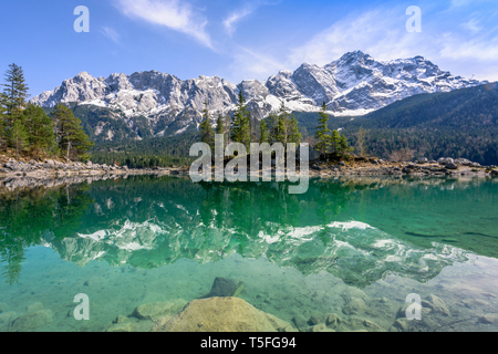 Zugspitze Mountain in turquoise Lake Eibsee with reflections, Garmisch-Partenkirchen, Bavaria, Germany - Stock Photo