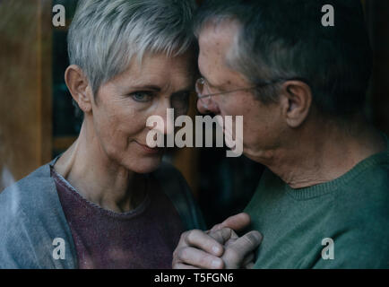 Senior man consoling sad wife - Stock Photo