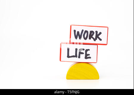 Work life balance concept with two blocks representing work and life - Stock Photo