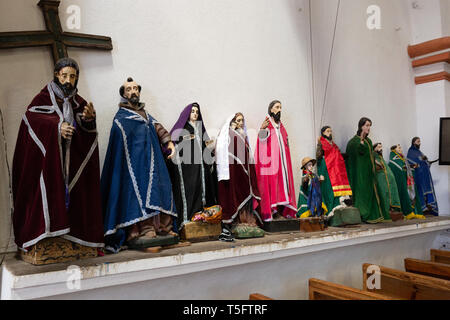 Wooden religious figures painted and costumed in St James the Apostle Church, Santiago Atitlan town, Guatemala, Central America - Stock Photo