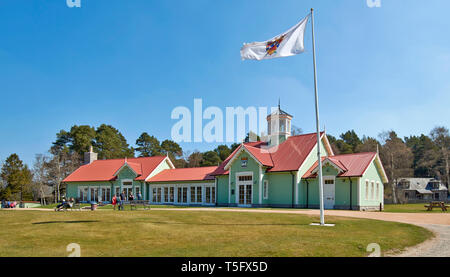 BRAEMAR ABERDEENSHIRE SCOTLAND THE DUKE OF ROTHESAY HIGHLAND GAMES PAVILION PEOPLE OUTSIDE THE RESTAURANT AND FLAG FLYING IN THE BREEZE - Stock Photo