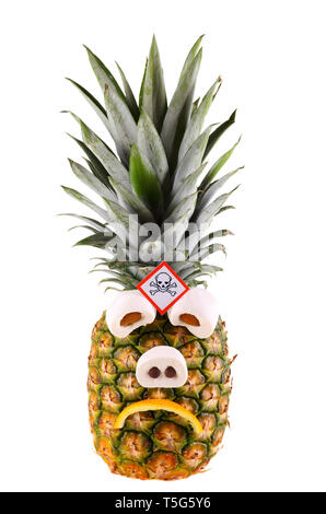 Sad pineapple with poison symbol - isolated on a white background. - Stock Photo