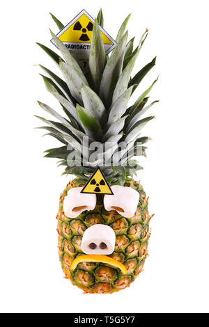 Sad pineapple with radioactive symbol - isolated on a white background. - Stock Photo