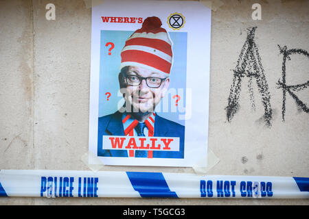 Westminster, London, UK, 24th April 2019. A police cordon has been put up at the site where the remaining Extinction Rebellion protesters are taken down from trees. Protesters have put up a 'Where's Wally' poster with the face of Michael Gove on it. Credit: Imageplotter/Alamy Live News - Stock Photo