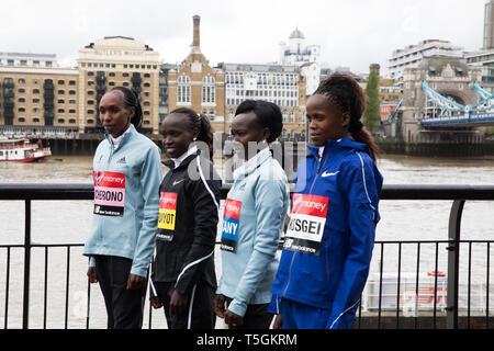 London, UK. 25th Apr, 2019. The London Marathon Elite Women's Photocall takes place outside the Tower Hotel with Tower Bridge in the background ahead of the Marathon on Sunday. Taking part are: Gladys Cherono(Ken), Vivian Cheruiyot(Ken), Mary Keitany(Ken) and Brigid Kosgei(Ken). Credit: Keith Larby/Alamy Live News - Stock Photo