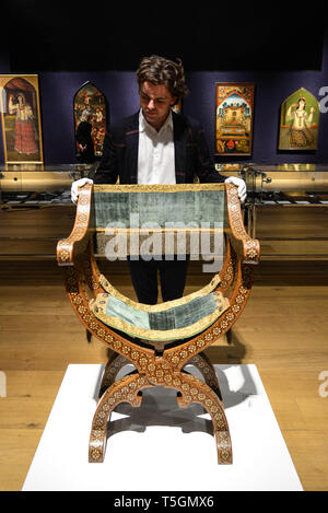 London, UK. 25th Apr, 2019. Photo call at Bonhams New Bond Street for Islamic and Indian Art sale being held on 30th April 2019. A Nasrid Or Post-Nasrid Taracea Chair Spain, 15Th/ 16Th Century £ 30,000 - 40,000. Credit: claire doherty/Alamy Live News