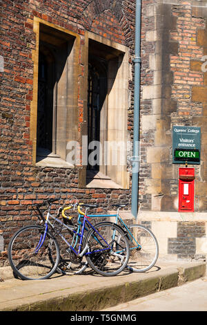 Pushbikes parked outside the entrance to Queens' College, Cambridge, Cambridgeshire, England - Stock Photo
