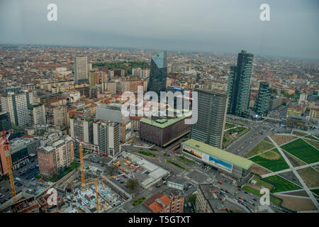 Milan Italy 10 April 2019: City of Milan seen from the palace of the lombrdia region at the end of the day - Stock Photo