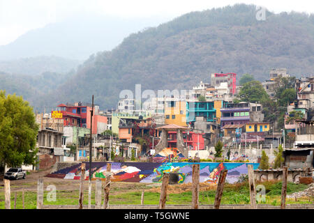Santiago Atitlan, Guatemala, Central America - colourful buildings of the town seen from Lake Atitlan, Guatemala, Latin America - Stock Photo