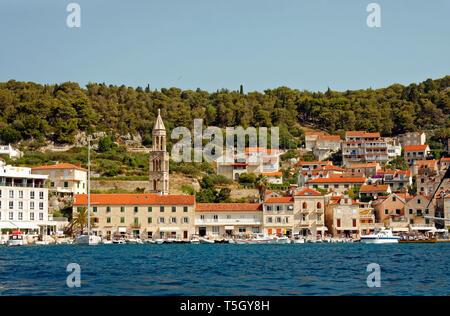 Hvar Town seen from Adriatic Sea; coastal scene, buildings; boats; hillside; Hvar, Croatia; Europe; summer, horizontal - Stock Photo