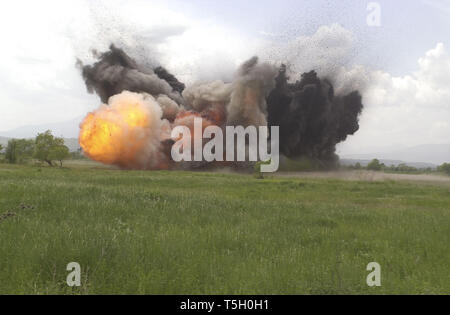 May 11, 2000 - Vitina, Kosovo, Yugoslavia - A mine clearing, line charge explodes during training outside Vitina, Kosovo, Yugoslavia, May 11, 2000..A MCLC is a 2000-pound mine clearing charge shot via rocket over a mine field that will clear a path during the explosion. (Credit Image: © Bill Putnam/ZUMA Wire) - Stock Photo
