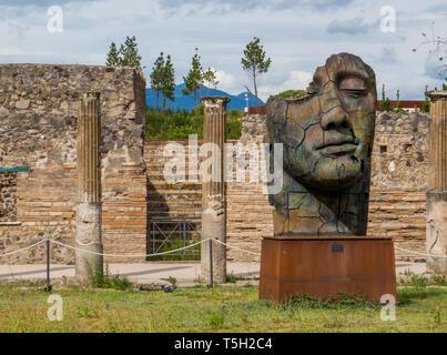 Sculptures of the Polish sculptor Igor Mitoraj on display at Pompeii archaeological site, Campania, Italy - Stock Photo