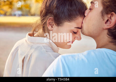 Young couple in love kissing outdoors