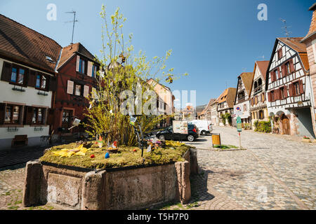 Bergheim, France - 19 Apr 2019: Easter eggs on the central tree in the French alsatian village in central Square  - Stock Photo