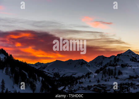 Fiery red skies at sunset over Obertauern, Austria - Stock Photo