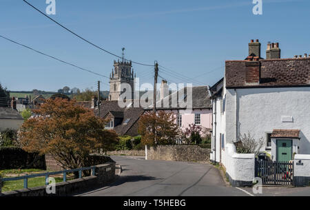 View looking through the village to the church of St Andrew, Colyton, Devon. UK - Stock Photo