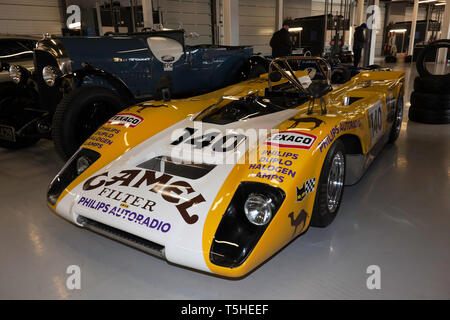 Three-quarter front view of a Yellow and White, 1971, Lola T212, in the International Pit Garages, at the 2019 Silverstone Classic Media Day - Stock Photo