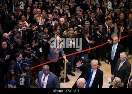 Massive crowd inside the Congress Center in Davos as the US President Donald J. Trump arrives to the World Economic Forum. former Secretary of State Rex Tillerson walks behind him. - Stock Photo
