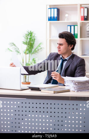 Young male employee working  in the office - Stock Photo