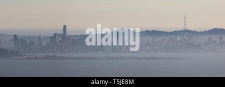 The northern California city of San Francisco skyline is seen through poor air quality at dusk. - Stock Photo