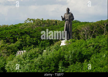 A large statue on the hillside near Uluwatu Temple (Pura Luhur Uluwatu) on the Bukit Peninsula in Bali, Indonesia - Stock Photo