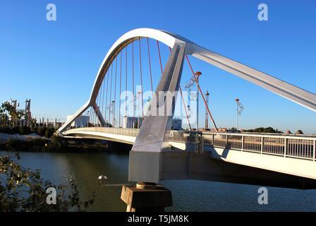 View of the Barqueta bridge (Puente de la Barqueta) over the Guadalquivir river, Seville, Seville Province, Andalusia, Spain. - Stock Photo