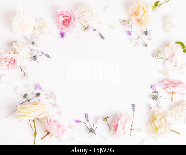 Festive flower composition on the white wooden background. Overhead view - Stock Photo