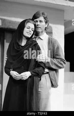 Scottish Actor Jim Smilie, and English actress Angela Richards, on stage during rehearsals for the play Zorba at The Greenwich Theatre, London, in November 1973. Smilie played the part of Nikos, and Richards was in the role as The Widow. - Stock Photo