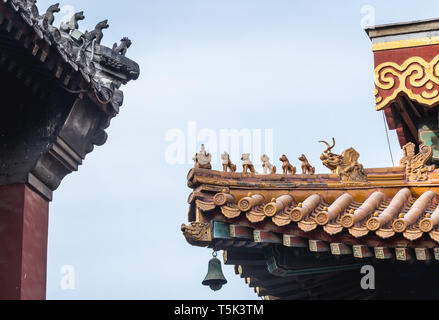 Roof details in Yonghe Temple also called Lama Temple of the Gelug school of Tibetan Buddhism in Dongcheng District, Beijing, China - Stock Photo