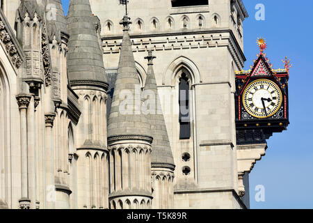London, England, UK. Royal Courts of Justice in the Strand. Clock by George Edmund Street (1824-1881), installed 1883 - Stock Photo