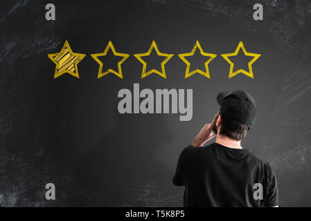 negative service rating or customer feedback concept with stars on blackboard - Stock Photo