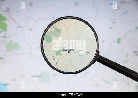 Bamako, Mali. Political map. City visualization illustrative concept on display screen through magnifying glass. - Stock Photo