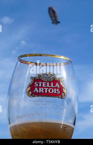 Front view of empty glass beer bottle isolated on white Stock Photo