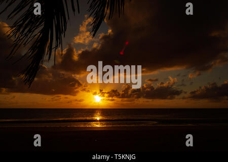 colorfull Sunrise over the coral sea at Cape Tributation in the Daintree region of far north Queensland - Stock Photo