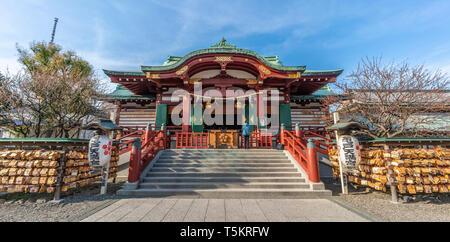 Tokyo, Japan - March 18, 2019 : Honden (Main Hall) of Kameido Tenjin-sha Shinto Shrine. Built in 1646 in honor of Sugawara no Michizane - Stock Photo