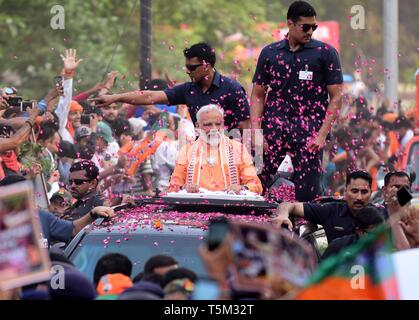 Varanasi, Uttar Pradesh, India. 25th Apr, 2019. Bhartya Janta party (BJP) leader and Indian Prime Minister NARENDRA MODI take part in a road show in Varanasi. Prime Minister Narendra Modi will file his election nomination on April 26th, from the Varanasi constituency for the parliamentary or general elections for India's 545-member lower house of parliament, or Lok Sabha, that is held every five years. Credit: Prabhat Kumar Verma/ZUMA Wire/Alamy Live News - Stock Photo