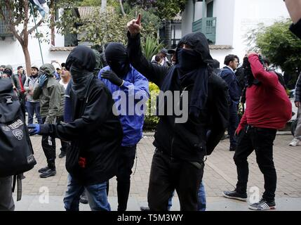 Bogota, Colombia. 25th Apr, 2019. Protesters participate in a national strike, in Bogota, Colombia, 25 April 2019, to protest against the economic and social policies of President Ivan Duque. Credit: Leonardo Munoz/EFE/Alamy Live News - Stock Photo
