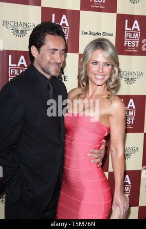 LOS ANGELES, CA - JUNE 21:  Demian Bichir_Stefanie Sherk  arrives at 'A Better Life' World Premiere Gala Screening during the 2011 Los Angeles Film Festival at Regal Cinemas L.A. LIVE on June 21, 2011 in Los Angeles, California.   People:   Demian Bichir_Stefanie Sherk - Stock Photo